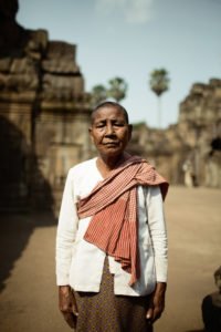 Khmer woman with her Kroma in the Wat Nokor pre-angkorian (around 10th century). Kroma is a Khmer scarf from the ancient times, made of silk or cotton is used everyday and in many ways. © Envela Castel, all rights reserved
